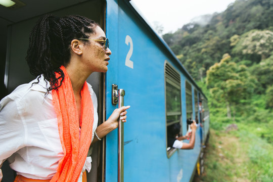 Woman Leaning Out Of A Train In The Countryside