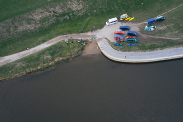 Aerial View Of The River With Canoes.