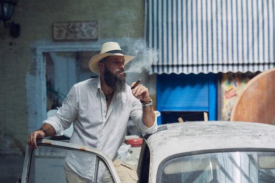 Man smoking cuban cigar.