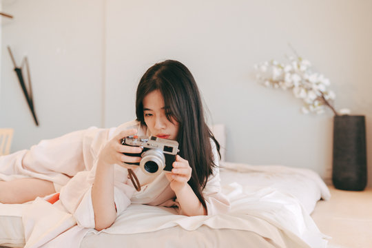sexy Asian woman in kimono in bedroom