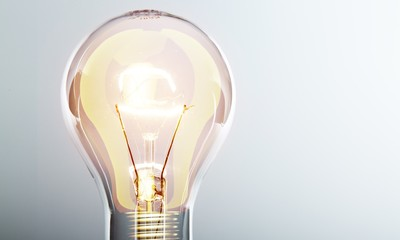 Glowing yellow light bulb, busienss idea concept