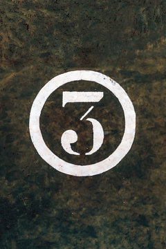Number 3 Printed on White Over Grunge Wall