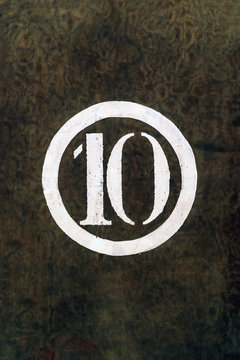 Number 10 Printed on White Over Grunge Wall