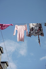 Urban clothesline high up in the sky, messed up by the wind