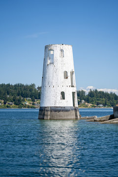 Abandoned lighthouse in the Puget Sound of Washington in the Pacific Northwest once used as a shipping port