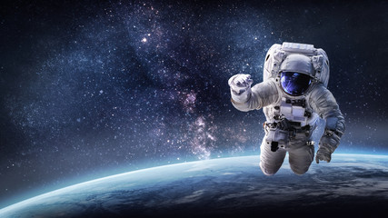 Astronaut in outer space on orbit of the Earth. Elements of this image furnished by NASA