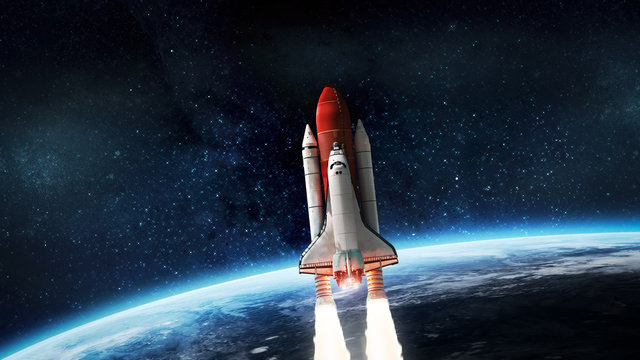 Space shuttle launch in outer space from Earth. Rocket on orbit of the planet. Elements of this image furnished by NASA