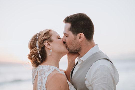 Wedding Couple Kissing at Sunset