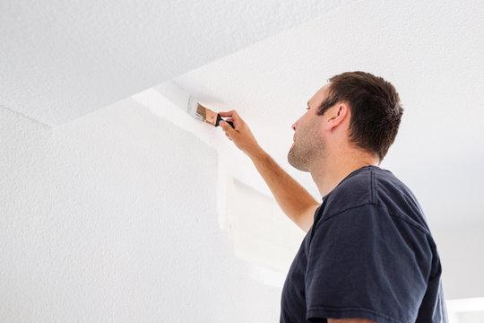 Man Painting Wall Working as a Volunteer