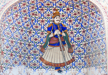 Colourful ancient wall painting at City Palace gate in Jaipur, India