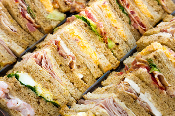 Foto op Canvas Snack Close up of a select.ion of sandwiches with different fillings on a tray