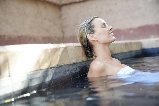 Woman relaxing in beautiful Moroccan swimming pool