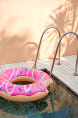 one bright inflatable donuts swimming in the pool