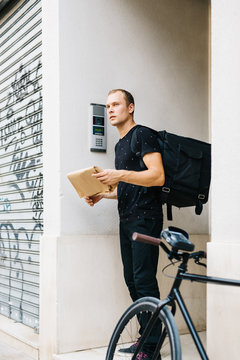 Man with delivery backpack and bicycle