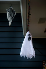 Halloween ghost decorations in front of house