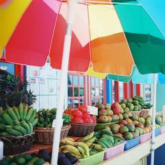 Rainbow umbrella on Kauai with outdoor fruit market