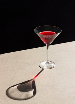 Direct view of red alcohol in cocktail glass kept on table