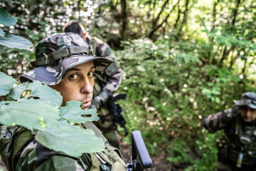 Special forces mercenary soldiers dogs of war in the forest during the combat battle operation on the mission patrol