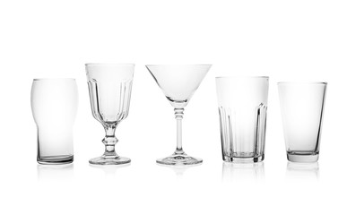 Spoed Foto op Canvas Alcohol Set of empty glasses for different drinks on white background