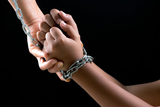 Child hands were tied with a chain. Stop Violence, Terrified,Children violence and abused concept.  Human Rights Day concept with copy space for advertisers.