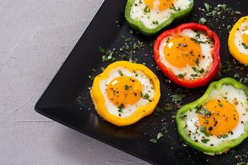 Yellow , red and green pepper with fried eggs