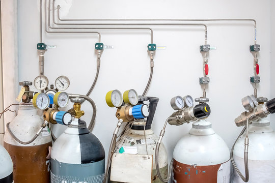 Valves of nitrogen, Helium, Oxygen ( Air Zero) tank and Gas Pressure Meter with Regulator for monitoring measure pressure production process in Chemistry Laboratory room