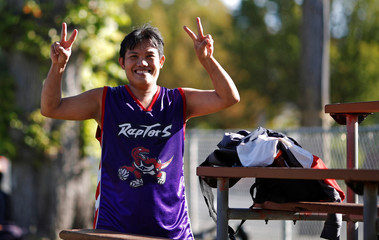 Nico Medes Besas Anabo from the Philippines gestures toward the camera after playing basketball at the Steve Nash Foundation basketball court prior to game five of the NBA basketball finals, in Victoria