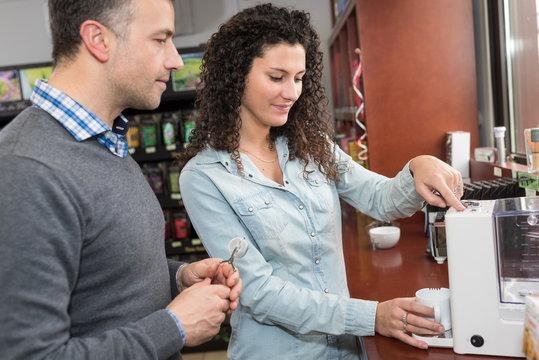 woman working on coffee factory tasting coffee