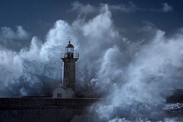 Big wave over old lighthouse Wall mural