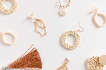 Pattern made of earrings on white background