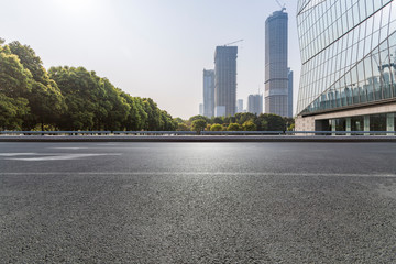 Panoramic skyline and modern business office buildings with empty road,empty concrete square floor Fototapete