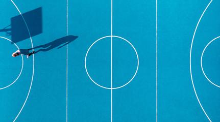 Basketball Player, Long Shadows on Basketball Court, Creative Visual Art, Aerial Image