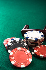 Poker or Roulette Casino Chips Close Up on Green Felt Casino Table