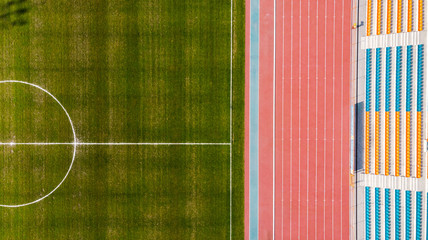 Athletic stadium and football grass pitch, aerial top down view