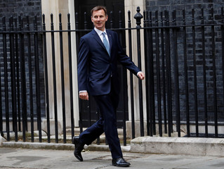 Britain's Foreign Secretary Jeremy Hunt arrives at Downing Street in London