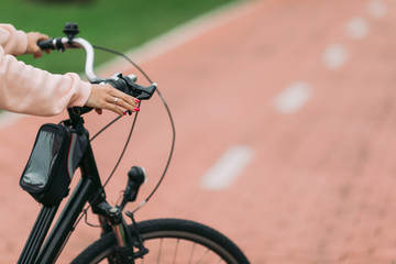woman cyclist riding a bike on bike path, close-up