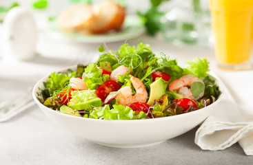 Fresh summer salad with shrimp, avocado and tomato