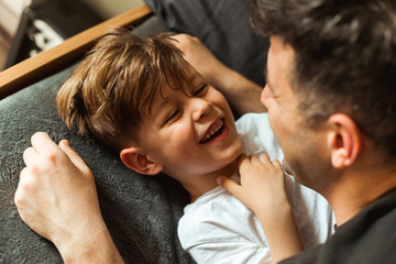 Smiling boy playing with his Dad