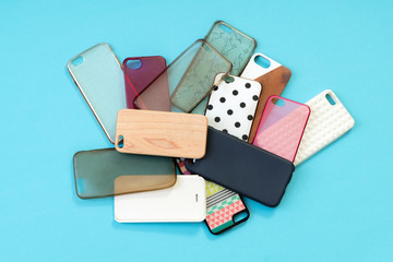 Pile of multicolored plastic back covers for mobile phones on bl