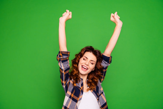 Portrait charming lovely sweet teen teenager fan celebrate shout yeah raise fists hands arms  feel crazy thrilled close eyes open mouth dressed checkered clothes isolated bright background