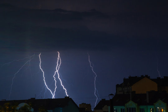 bright flashes of lightning in the night sky over the city