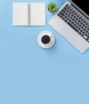 Business concept, relaxation in working time, drinking coffee taking a break on clean light blue office table, copy space, flat lay, top view, mockup