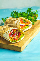 Shawarma sandwich with grilled meat, vegetables, cheese