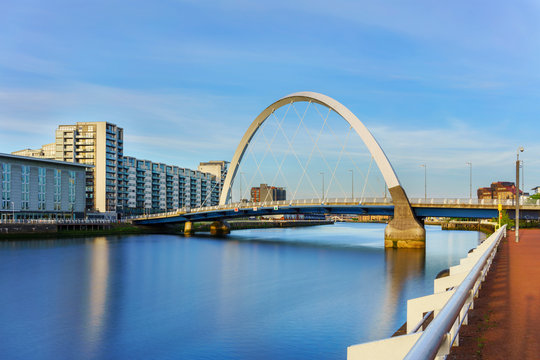 The Clyde Arc Bridge or the Squinty Bridge crossing the river Clyde In Glasgow , Scotland , UK