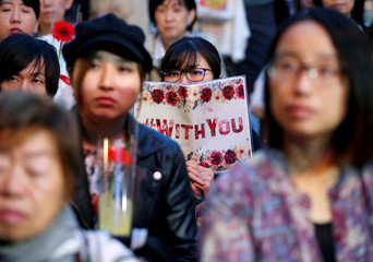 Protesters gather at the rally called 'Flower Demo' to criticize recent acquittals in court cases of alleged rape in Japan and call for revision of the anti-sex crime law, in Tokyo