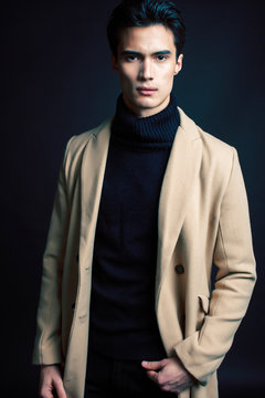 handsome asian fashion looking man posing in studio on black background, lifestyle modern people concept close up