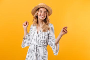 Beautiful young blonde woman wearing summer dress