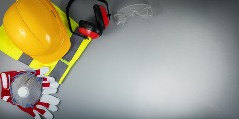 work safety items of construction industry on gray background with copy space