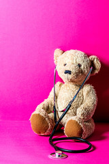 cute teddy bear with a stethoscope for child healthcare learning