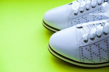 07287e760 fashionable New women sneakers with laces.White oxford shoes isolated on  yellow background.Leather